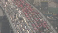 High Angle static - Bumper-to-bumper traffic inches along a freeway. / Moscow, Russian Federation