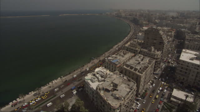 High Angle, static - High rises and roads populate the shoreline of a bay / Egypt