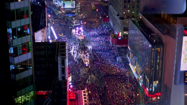 High angle time lapse large crowds of people in Times Square at night on New Year's Eve / Manhattan, New York City