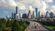High angle view of a multiple lane highway with skyscrapers in the background, Houston, Texas, USA