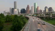 High angle view of a multiple lane highways with skyscrapers in the background, Houston, Texas, USA