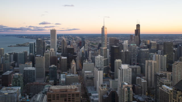 High angle view of Chicago skyline and suburbs looking south in the evening, Chicago, Illinois, USA.