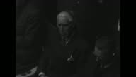 MCU high angle view of German Ambassador Fritz von Papen listening during war crimes trial with Nazi Chancellor of Austria Arthur SeyssInquart to his...
