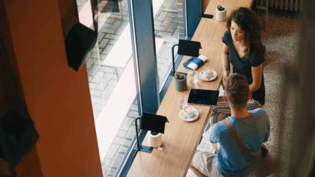 High angle view of young couple in cafe