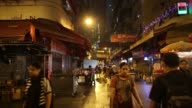 High angle view workers clean a street with hose and brushes in the Kwai Chung area of Hong Kong China on Monday Sept 30 Pan a man pushes a trolley...