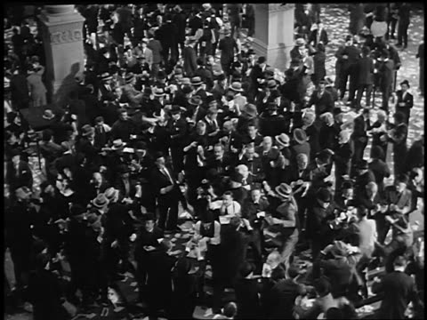B/W 1929 REENACTMENT high angle wide shot crowd of frenzied stockbrokers on stock exchange floor during crash
