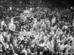 B/W 1929 high angle wide shot PAN crowded floor of New York Stock Exchange / newsreel