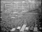 B/W 1960 high angle wide shot huge crowd in plaza at rally / Algeria / newsreel