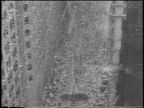 B/W 1938 high angle wide shot long shot ticker tape parade on Broadway for Douglas 'Wrong Way' Corrigan / NYC
