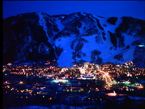 high angle wide shot of lit up Aspen at night / Colorado