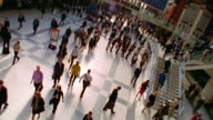 High angle wide shot pan crowd of commuters walking in Liverpool Street Station / London