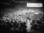 B/W 1958 high angle wide shot REAR VIEW crowd of seated garment workers in Madison Square Garden strike NYC