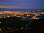 high angle wide shot PAN time lapse city in valley at dusk / Christchurch, South Island / New Zealand