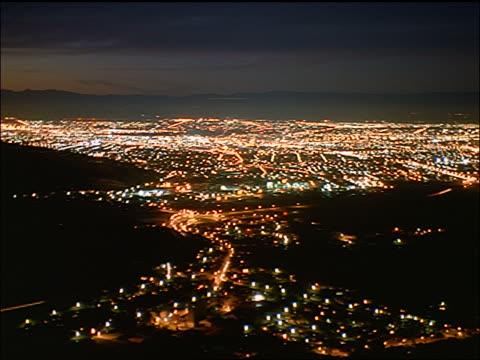 high angle wide shot PAN time lapse city in valley at night / Christchurch, South Island / New Zealand