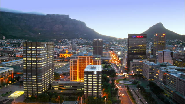 High angle wide shot time lapse traffic and Cape Town city skyline w/mountains in background
