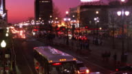 High angle wide shot time lapse traffic and crowds of people on street at night / New Orleans, Louisiana