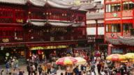 High angle wide shot tourists visiting Yuyuan Bazaar / Shanghai