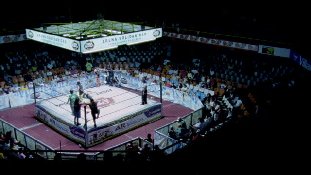High angle wide shot wrestling match in sports arena/ Monterrey, Mexico