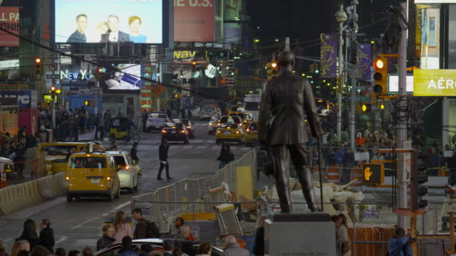 High angle wide slow motion shot of pedestrians in city intersection / New York, New York, United States