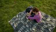 High angle woman texting on blanket Central Park New York City