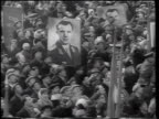 B/W 1961 high angle zoom in crowd holding posters with photographs of Yuri Gagarin / Moscow