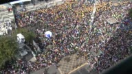 High Angle Zoom In Shot crowds gather on Copacabana Beach to take part in the Pope's final Mass in Brazil Pope Francis arrived for his final mass on...