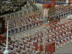 1972 high angle zoom out parade through Red Square with marchers flags and floats / Moscow USSR