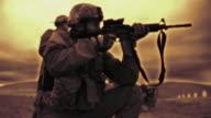 High contrast shot of kneeling soldier at target range