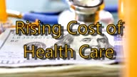 High cost of healthcare. US currency, prescription medicines, stethoscope.