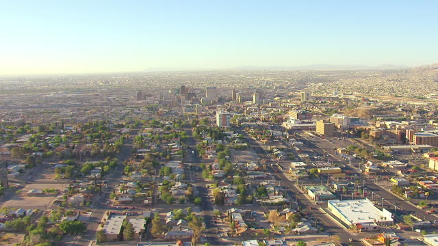WS AERIAL high over City and approach downtown / El Paso, Texas, United States