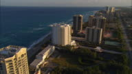 LOW AERIAL High rise condos and beach at Singer Island, Florida, USA