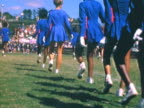 MONTAGE High school cheerleaders performing on football field / Mill Valley, California, United States