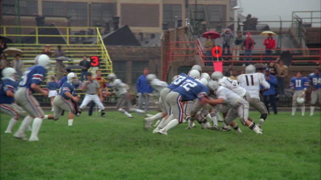 WS PAN High school football teams playing on field