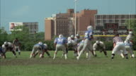 WS PAN High school football teams playing on field