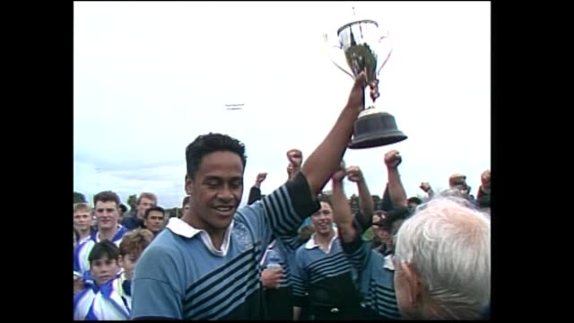 High school student Jonah Lomu accepting trophy as winning Wesley College captain from Ron Don at 1993 New Zealand Secondary Schools Condor rugby...