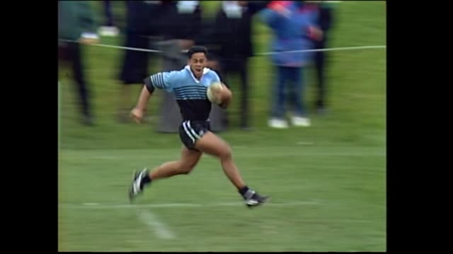 High school student Jonah Lomu scoring second of his four tries for Wesley College during the final of the 1993 New Zealand Secondary Schools Condor...
