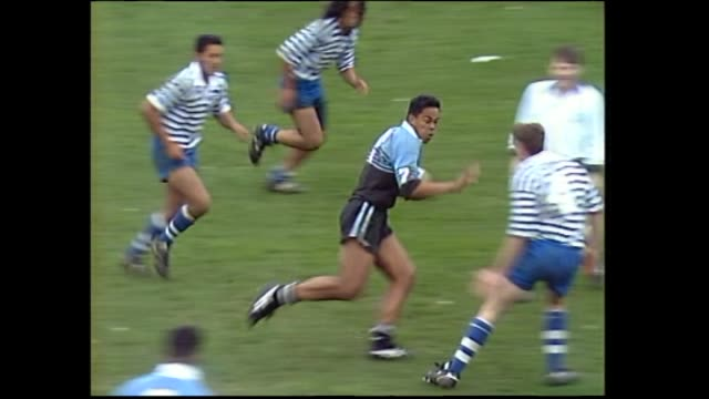 High school student Jonah Lomu scoring third of his four tries for Wesley College during the final of the 1993 New Zealand Secondary Schools Condor...