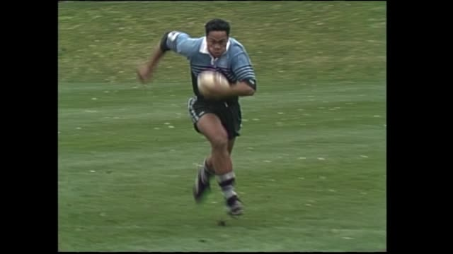 High school student Jonah Lomu scoring try for Wesley College in semifinal at 1993 New Zealand Secondary Schools Condor rugby Sevens tournament in...