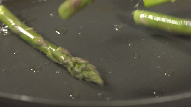 High speed asparagus tips falling in to frying pan