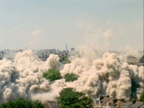 WA high speed demolition of two tower blocks, Hackney, area of regeneration for the Olympics 2012 London, UK
