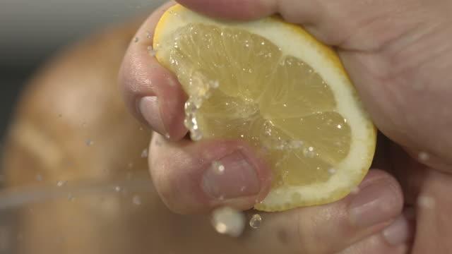 High speed hand squeezing lemon