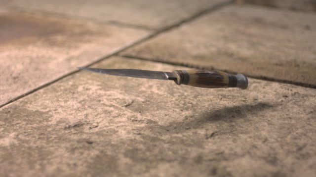High speed Knife falling on pavement