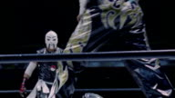 High speed medium shot pan member of luchador duo 'Orientals' throwing opponent into teammate/ opponent hitting masked wrestler as other masked wrestler joins fight/ Monterrey, Mexico