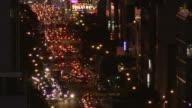 High volume traffic New York City street on a clear night