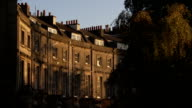 High windows, dormers, and chimneys characterize Georgian terraces in Bath. Available in HD.