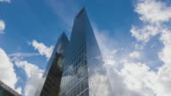 T/L Highlight Towers in Munich with reflecting clouds