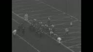[Highlights of 1929 season various games] Three shots of huge crowd in Soldier Field in Chicago for games between Fighting Irish of Notre Dame...