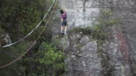 A highliner sets up the rigging for a new highline between cliffs at Corroboree Walls in Mount Victoria on March 6 2015 in the Blue Mountains...