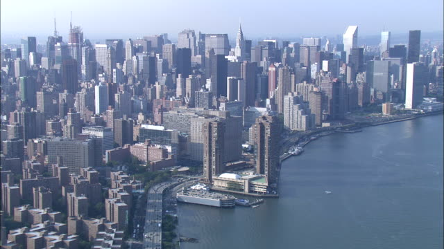 High-rises and office buildings crowd the shore of New York City. Available in HD.