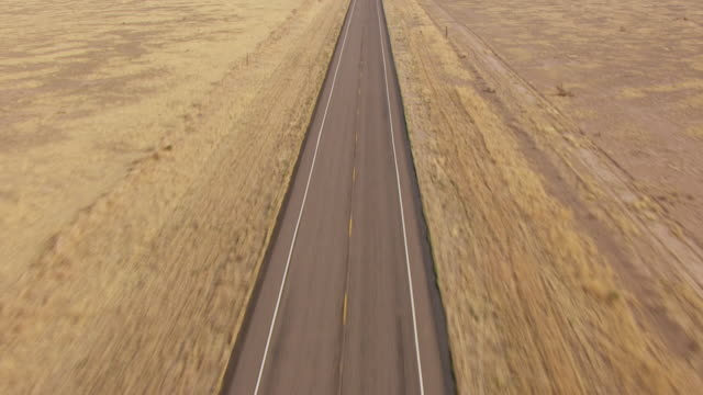 WS AERIAL TU LA Highway 17 in Big Bend Country in Chihuahuan Desert with mountains in back side / Marfa, Texas, United States